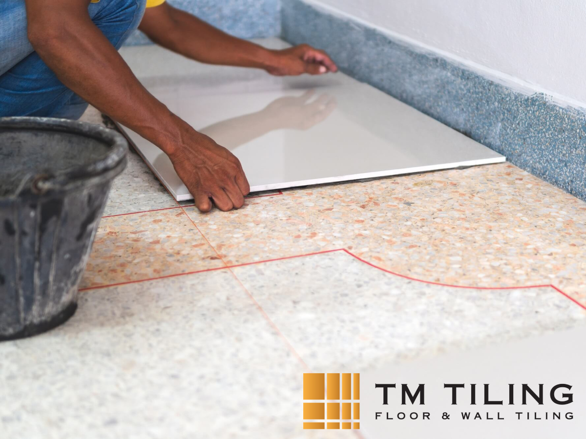 worker-conducting-overlay-tiling-tile-installation-and-renovation-tm-tiling-singapore
